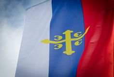 Flag of the Serbian orthodox church. Close up with cloudy blue sky royalty free stock images