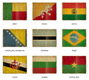 Flag set 3. Collection of grunge weathered flags. Nine pieces Stock Photos