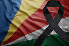 Flag of seychelles with black mourning ribbon Royalty Free Stock Images