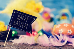 Flag-shaped signboard with the text happy easter Stock Photography