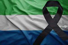 Flag of sierra leone with black mourning ribbon Royalty Free Stock Photography