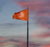 Flag with a sign Om or Aum. Is a sacred, mystical syllable in the Dharma or Indian religions, i.e. Hinduism, Jainism, and Buddhism Stock Image