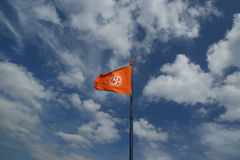 Flag with a sign Om or Aum Stock Photo
