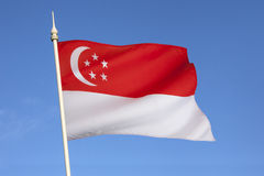 Flag of Singapore - City State. The national flag of Singapore was first adopted in 1959, the year Singapore became self-governing within the British Empire. It Royalty Free Stock Images