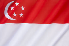 Flag of Singapore. The national flag of Singapore was first adopted in 1959, the year Singapore became self-governing within the British Empire. It was Royalty Free Stock Photos