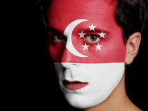 Flag of Singapore. Painted on a Face of a Young Man Stock Photography