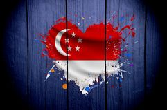 Flag of Singapore in the shape of heart on a dark background royalty free stock photography