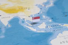 The Flag of singapore in the world map royalty free stock photography