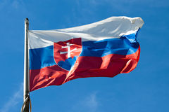Flag of Slovakia. Waving in the wind against a blue sky Stock Photos