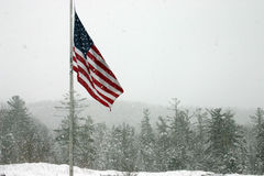 Flag in Snow Storm. American flag flying in a light snow fall stock photos