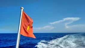 Flag of the socialistic republic of Vietnam on a ferry Royalty Free Stock Photos