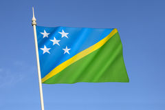 Flag of the Solomon Islands. Adopted on 18th November 1977. The five main island groups are represented by the five stars. The blue represents the ocean Royalty Free Stock Photo