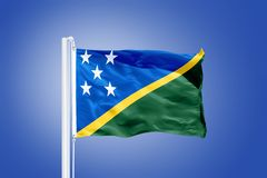 Flag of Solomon Islands flying against a blue sky Stock Photos