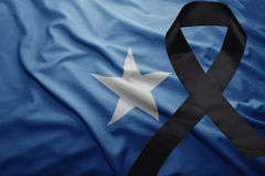 Flag of somalia with black mourning ribbon Stock Image