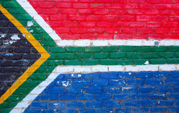 Flag South Africa. A brick wall painted in the colors and shape of the national flag of South Africa, the rainbow nation Stock Photos