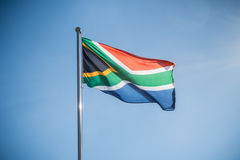 Flag of South Africa against blue sky Royalty Free Stock Image