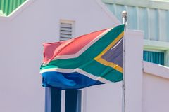 Flag of South Africa and traditional white building background royalty free stock photography