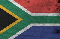 Flag of South Africa on wooden plate background. Grunge South Africa flag texture. Flag of South Africa on wooden plate background. Grunge South Africa flag royalty free stock photo