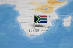 The Flag of south africa in the world map royalty free stock photo
