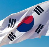 Flag of South Korea against the blue sky.  royalty free stock photos