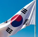 Flag of South Korea against the blue sky.  royalty free stock photo
