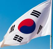 Flag of South Korea against the blue sky.  royalty free stock photography