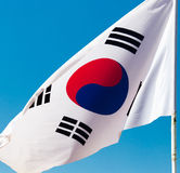 Flag of South Korea against the blue sky.  royalty free stock image