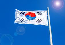 Flag of South Korea flying in the wind against the sky. Flag of South Korea flying in the wind against the blue sky royalty free stock photography