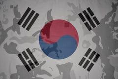 Flag of south korea on the khaki texture . military concept. Flag of south korea on the khaki texture background. military concept stock photo