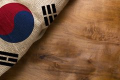 Flag of South Korea. Made from rough fabric on a wooden background royalty free stock photo