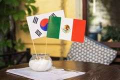 Flag of South Korea and Mexico in a saltcellar in a restaurant during the FIFA World Cup Russia 2018.  royalty free stock image