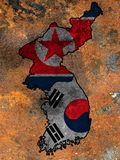 Flag of South Korea and North Korea on rusty metal background. stock images