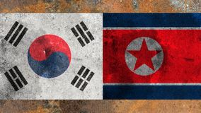 Flag of South Korea and North Korea on rusty metal background. royalty free stock photography