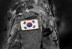Flag of South Korea on soldiers arm. Flag of South Korea on military uniforms (collage). royalty free stock image