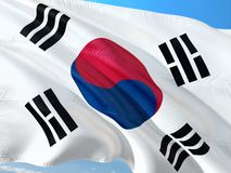 Flag of South Korea waving in the wind against deep blue sky. High quality fabric stock photography
