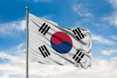 Flag of South Korea waving in the wind against white cloudy blue sky. South Korean flag stock photos