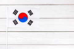 Flag of South Korea on white wooden background top view.  stock images