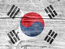 Flag of South Korea on a wooden background. Flag of South Korea painted on a wooden background royalty free stock image