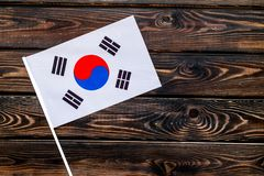 Flag of South Korea on wooden background top view.  royalty free stock photography
