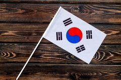 Flag of South Korea on wooden background top view.  royalty free stock photo