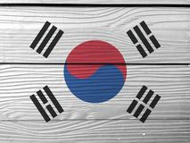 Flag of South Korea on wooden wall background. Grunge South Korea flag texture. royalty free stock photos