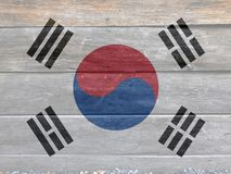 Flag of South Korea on wooden wall background. Grunge South Korean flag texture. Flag of South Korea on wooden wall background. Grunge South Korean flag texture royalty free stock photography