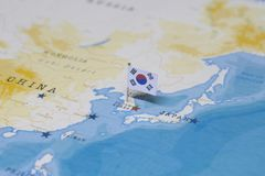 The flag of South Korea in the world map.  royalty free stock photography