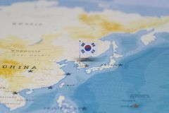 The flag of South Korea in the world map.  stock image