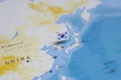 The flag of South Korea in the world map.  royalty free stock image