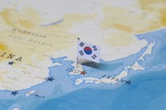 The flag of South Korea in the world map.  royalty free stock photo