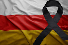 Flag of south ossetia with black mourning ribbon. Waving national flag of south ossetia with black mourning ribbon Royalty Free Stock Photo