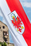 Flag of South Tyrol and castle in Chiusa Royalty Free Stock Images
