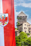 Flag of South Tyrol and castle in Chiusa Stock Image