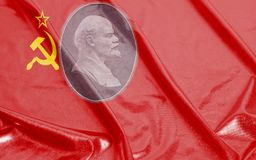 Flag of the Soviet Union with portraits of Vladimir Lenin. Background close up royalty free stock photography